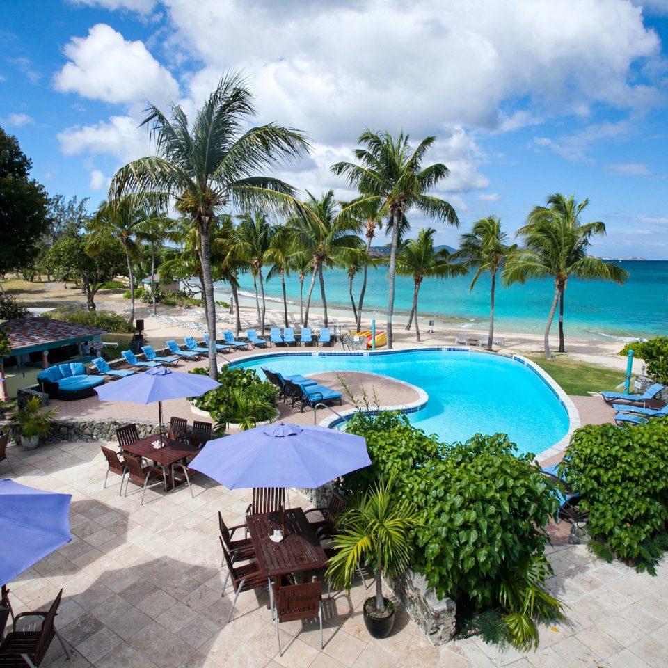 Beach Beachfront Dining Island Patio Pool tree sky umbrella swimming pool leisure property Resort caribbean Nature palm Lagoon Villa condominium plant Garden sandy