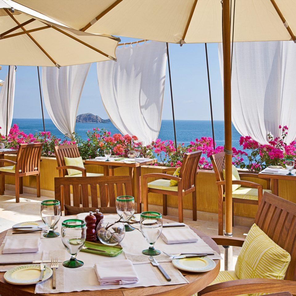 Beach Beachfront Dining Honeymoon Hotels Island Luxury Mexico Romance Romantic Rooftop Tulum chair restaurant wedding Resort function hall set