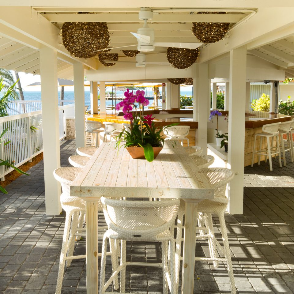 Beach Beachfront Dining Resort property building home porch cottage farmhouse mansion Kitchen Villa living room