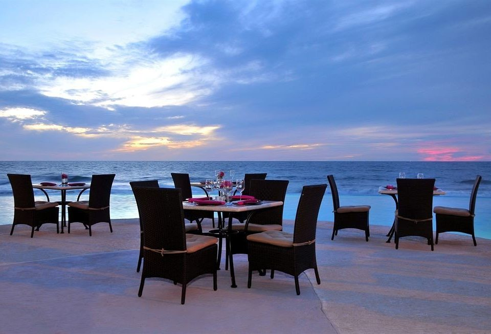 Beachfront Dining Resort Sunset sky chair Beach Sea evening day dining table