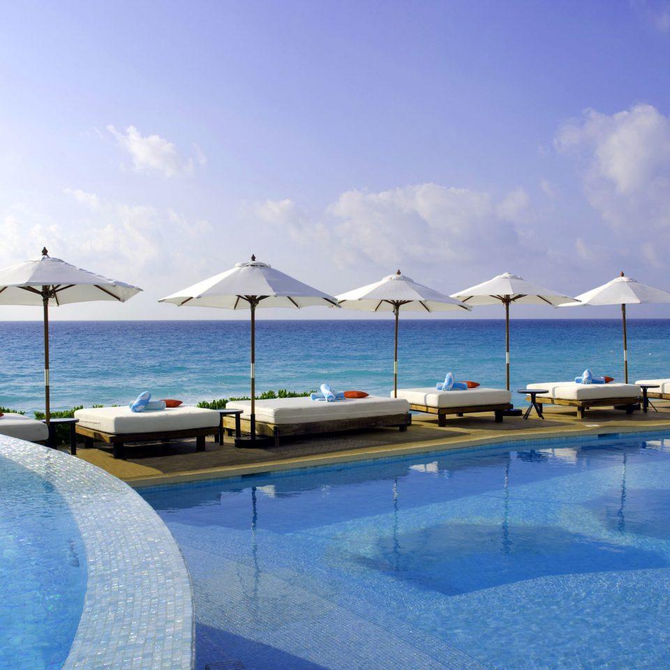 Beach Beachfront Drink Eat Hotels Luxury Ocean Pool sky water swimming pool Sea property leisure Resort Lagoon caribbean blue swimming day