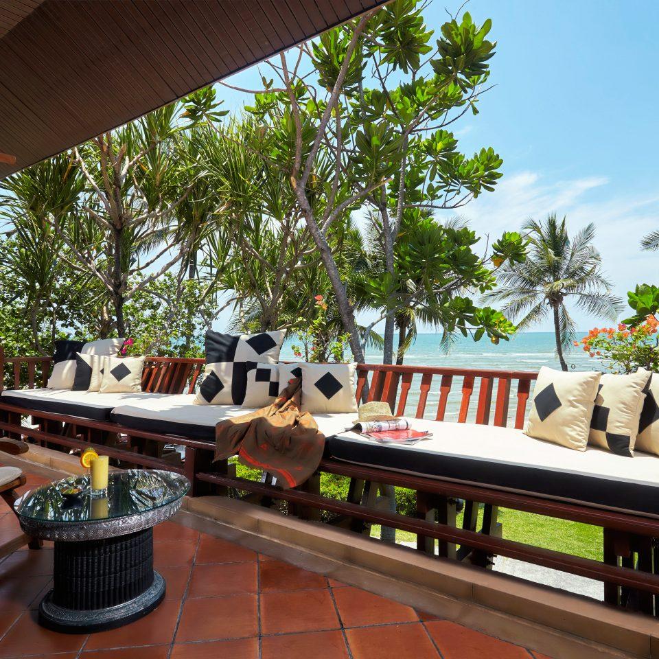 Beach Beachfront Drink Eat Lounge Ocean tree property Resort home Villa restaurant backyard hacienda cottage
