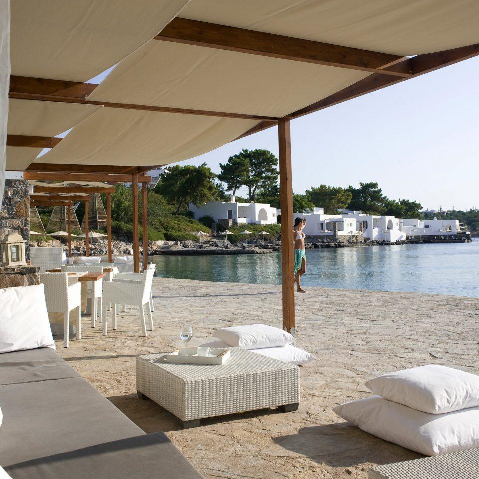 Beach Beachfront Drink Hip Luxury Romance Scenic views water property Resort home swimming pool white Villa