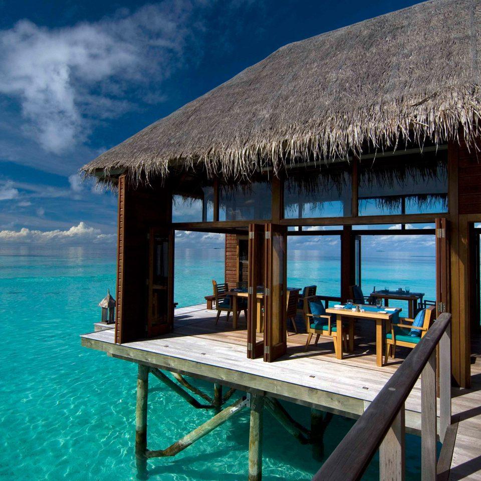 Beach Beachfront Elegant Hip Hotels Lounge Luxury Modern Ocean water chair umbrella leisure mountain Pool Resort swimming pool Sea caribbean overlooking Villa swimming Island