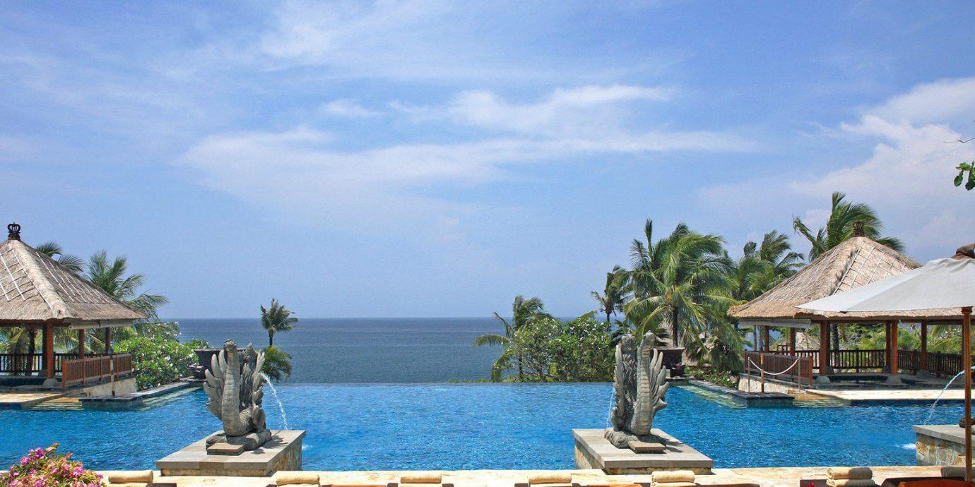 Beach Beachfront Elegant Luxury Modern Pool Scenic views sky chair leisure property Resort caribbean swimming pool wooden Sea lawn Lagoon Villa