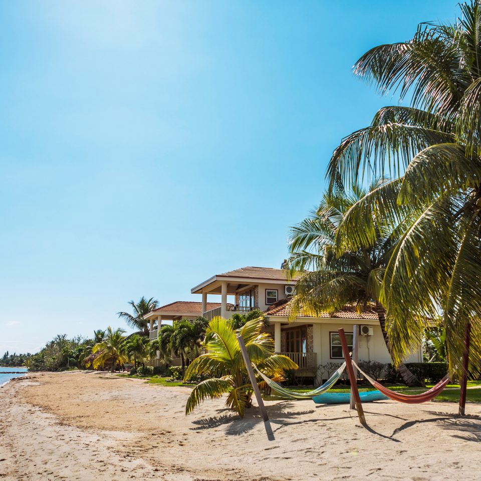 Beach Beachfront Exterior Family Grounds Island Resort Scenic views Tropical Villa Waterfront sky tree water ground Sea tropics arecales caribbean shore plant palm family palm sandy shade