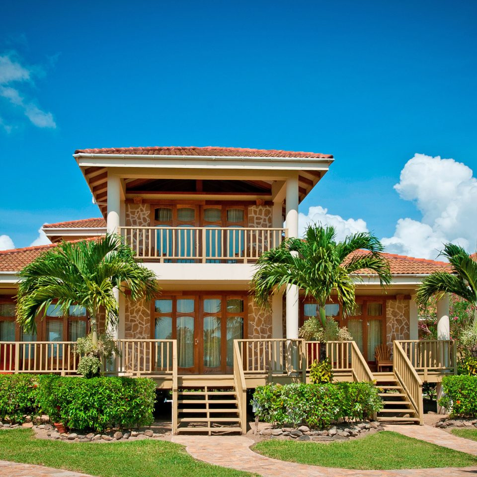 Beach Beachfront Exterior Family Grounds Island Resort Tropical Villa Waterfront sky tree property building house home mansion palm arecales residential area palace plant Garden