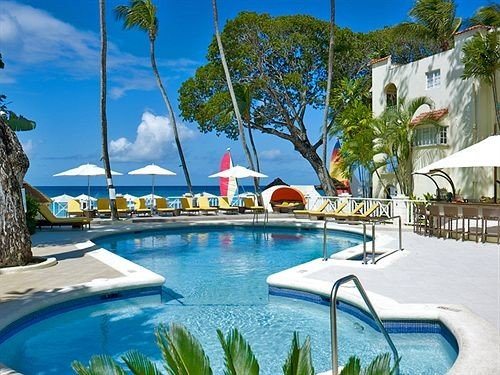 Beach Beachfront Exterior Lounge Pool sky swimming pool leisure property Resort caribbean Villa condominium resort town Water park Lagoon backyard mansion swimming day