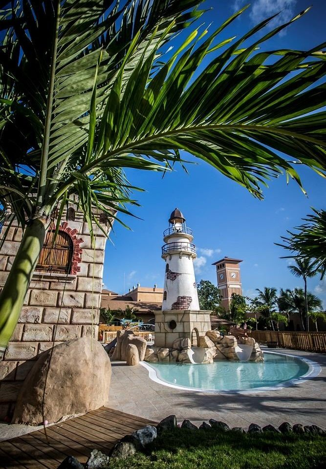 Beach Beachfront Exterior Lounge Ocean Pool Tropical tree plant landmark arecales palm family tropics palm tower water feature Sea Resort stone shade
