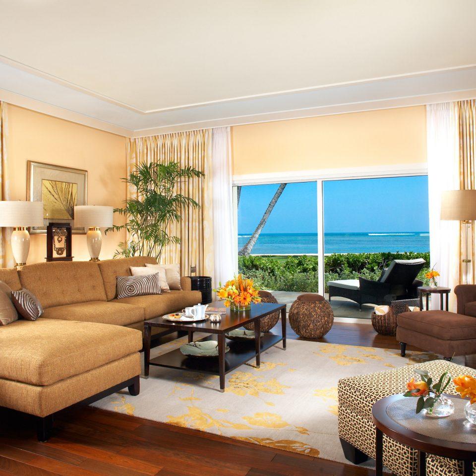 Beach Beachfront Family Island Lounge Patio Resort Romantic Scenic views Suite sofa living room property condominium home hardwood Villa flat