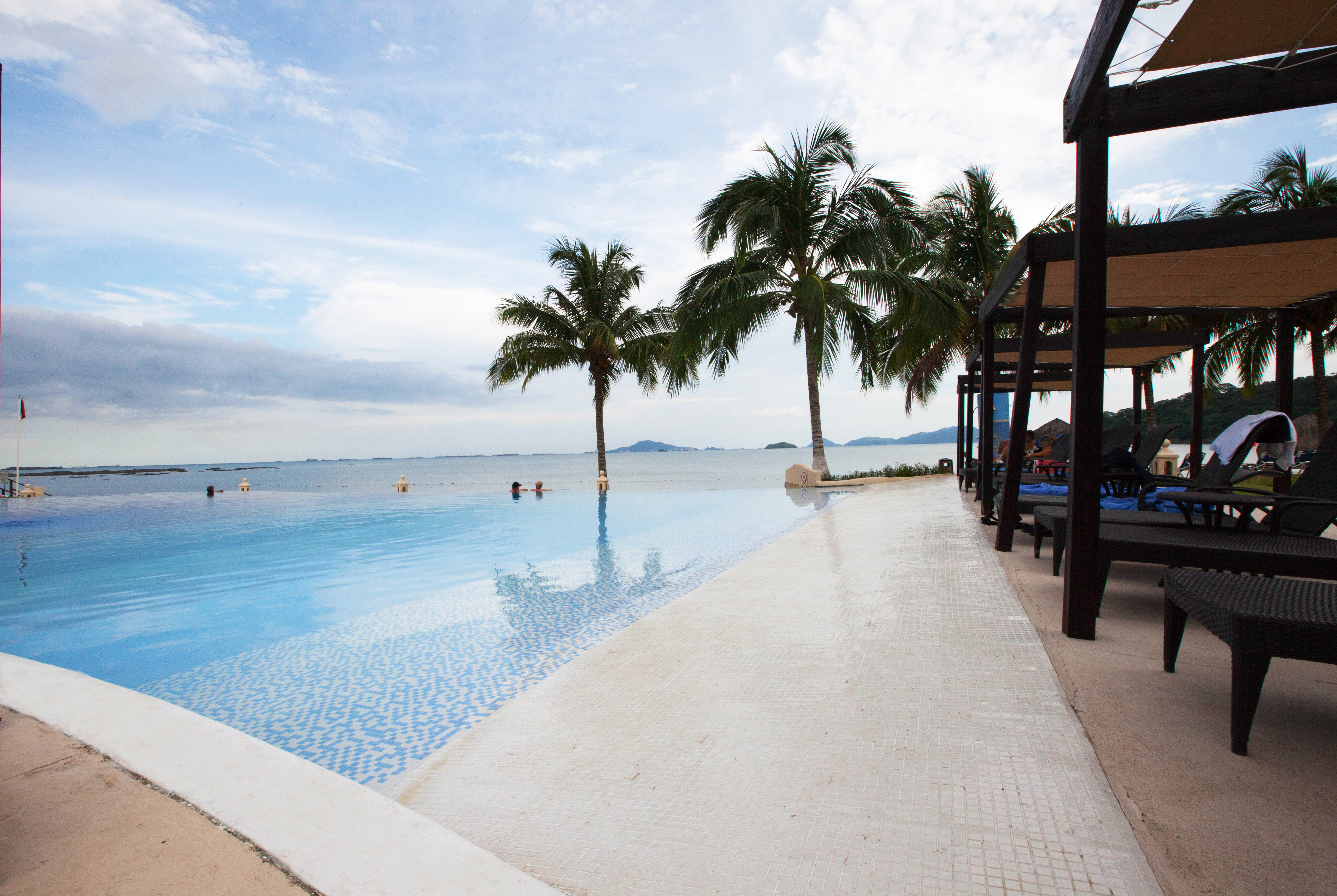 Beachfront Family Play Pool Resort sky water Beach Sea Ocean caribbean arecales walkway swimming pool travel shore lined swimming day
