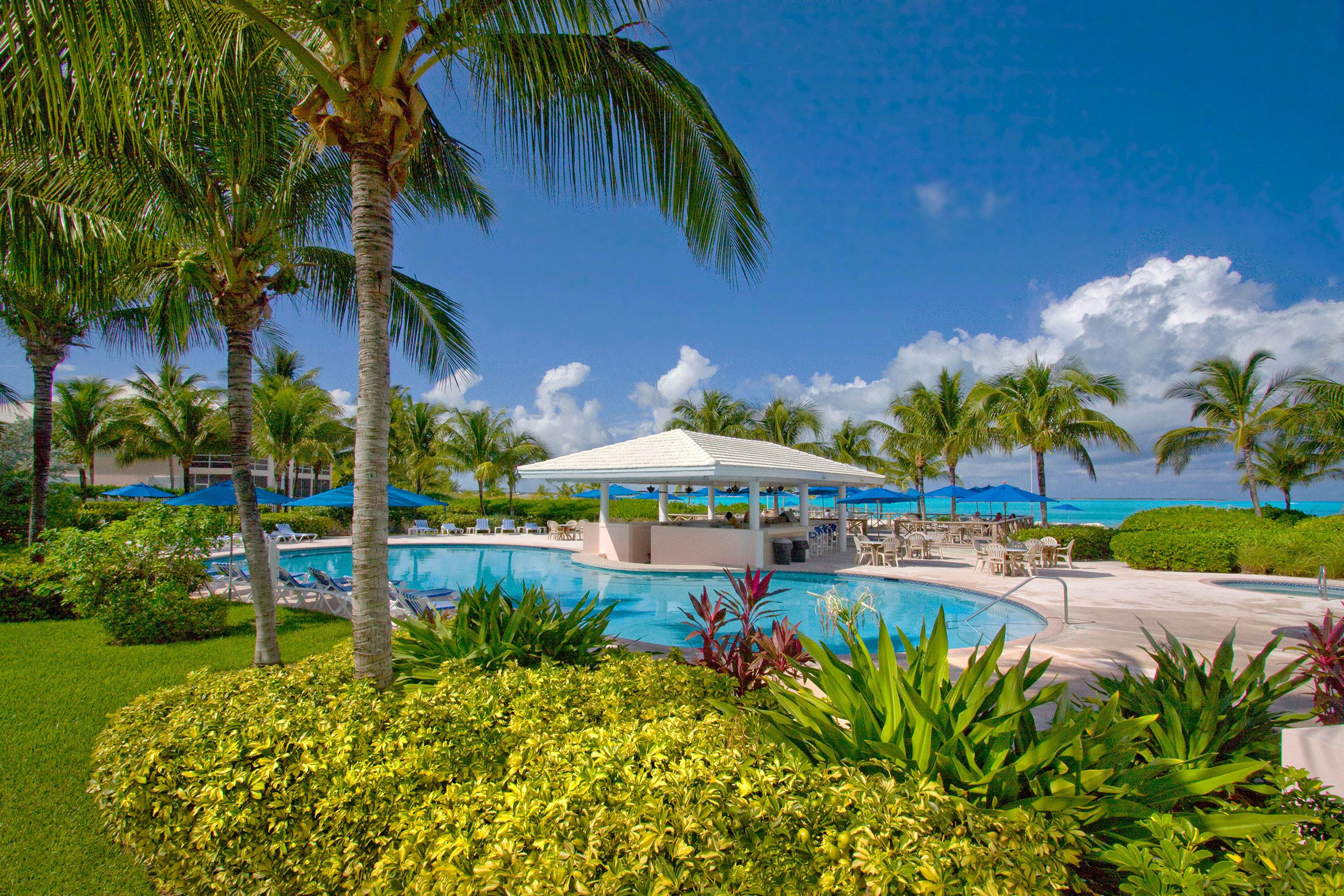Beachfront Grounds Play Pool Resort tree grass property palm caribbean Beach swimming pool arecales plant Lagoon tropics Villa lawn Garden shore