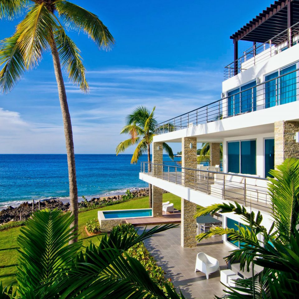 Beachfront Grounds Luxury tree palm leisure caribbean Resort Beach condominium plant arecales Ocean palm family tropics lawn Sea walkway shore Garden overlooking