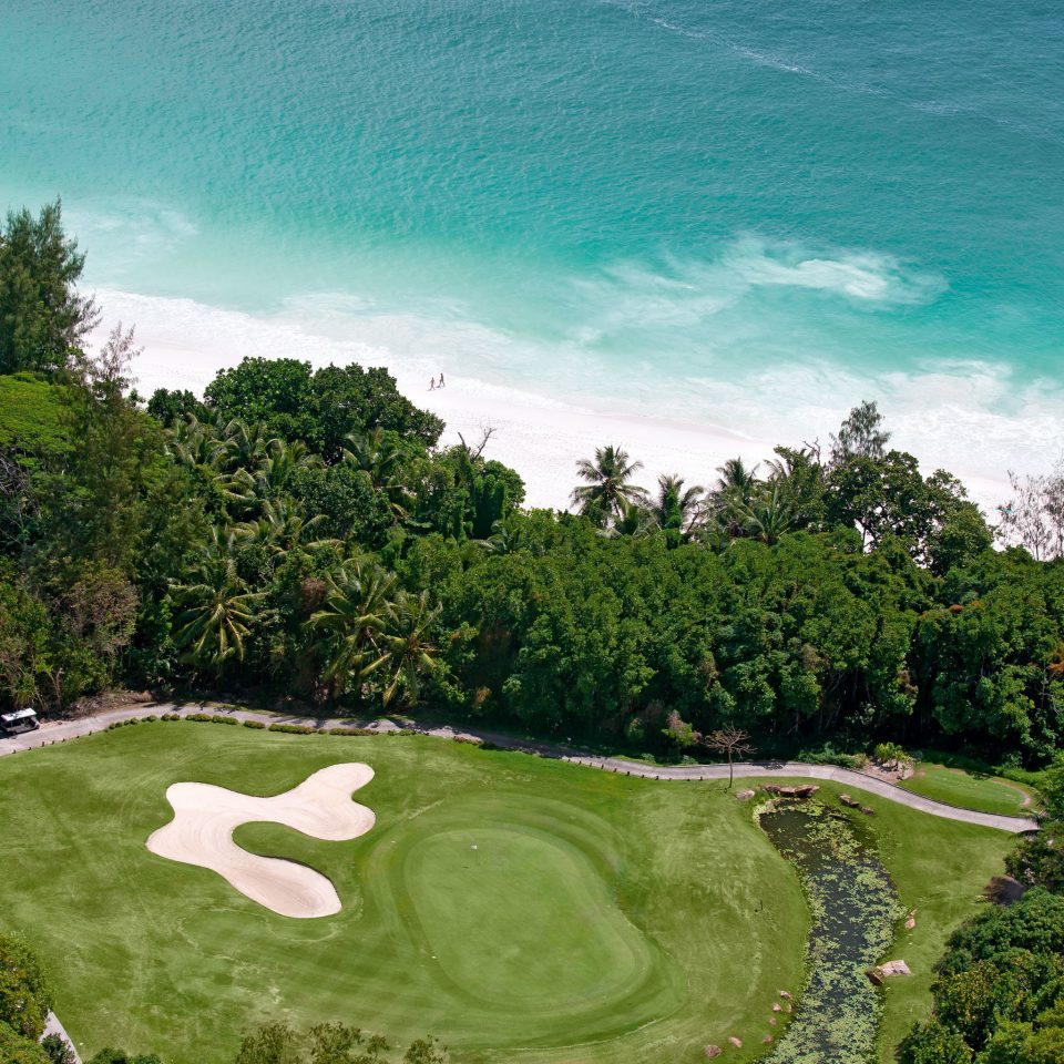Beach Beachfront Golf Island Jungle Outdoors Play Scenic views Sport Wellness tree structure green Nature sport venue grass golf course aerial photography lawn golf club sports reef lush surrounded hillside