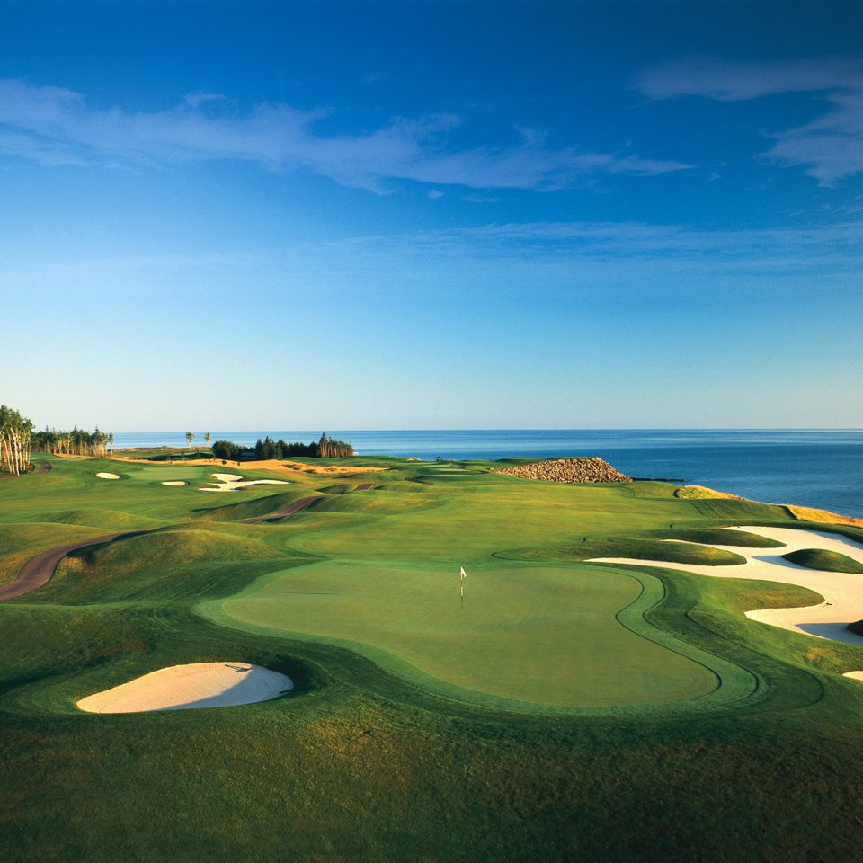 Beach Beachfront Golf Ocean sky grass structure Nature grassland sport venue horizon golf course plain golf club sports Sea day