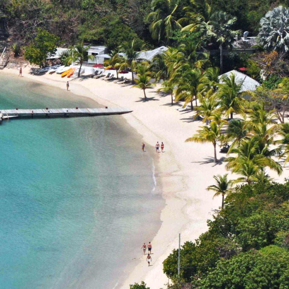 Beach Beachfront Grounds Inn Play Scenic views tree Nature Resort swimming pool Water park park surrounded shore