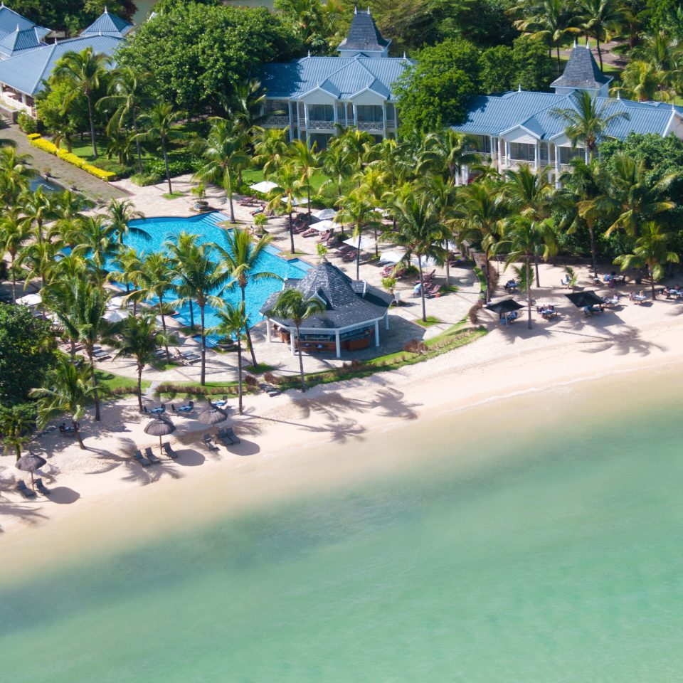 Beach Beachfront Grounds Island Romance Romantic Scenic views tree water Nature Resort Pool Water park caribbean Sea shore swimming surrounded