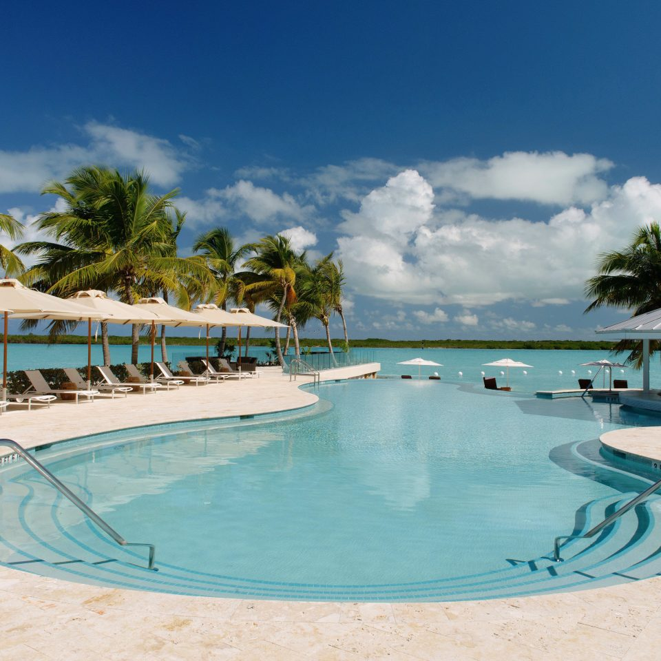 Beachfront Grounds Play Pool Resort sky swimming pool leisure Beach property caribbean Lagoon Ocean Sea shore Villa swimming sandy day