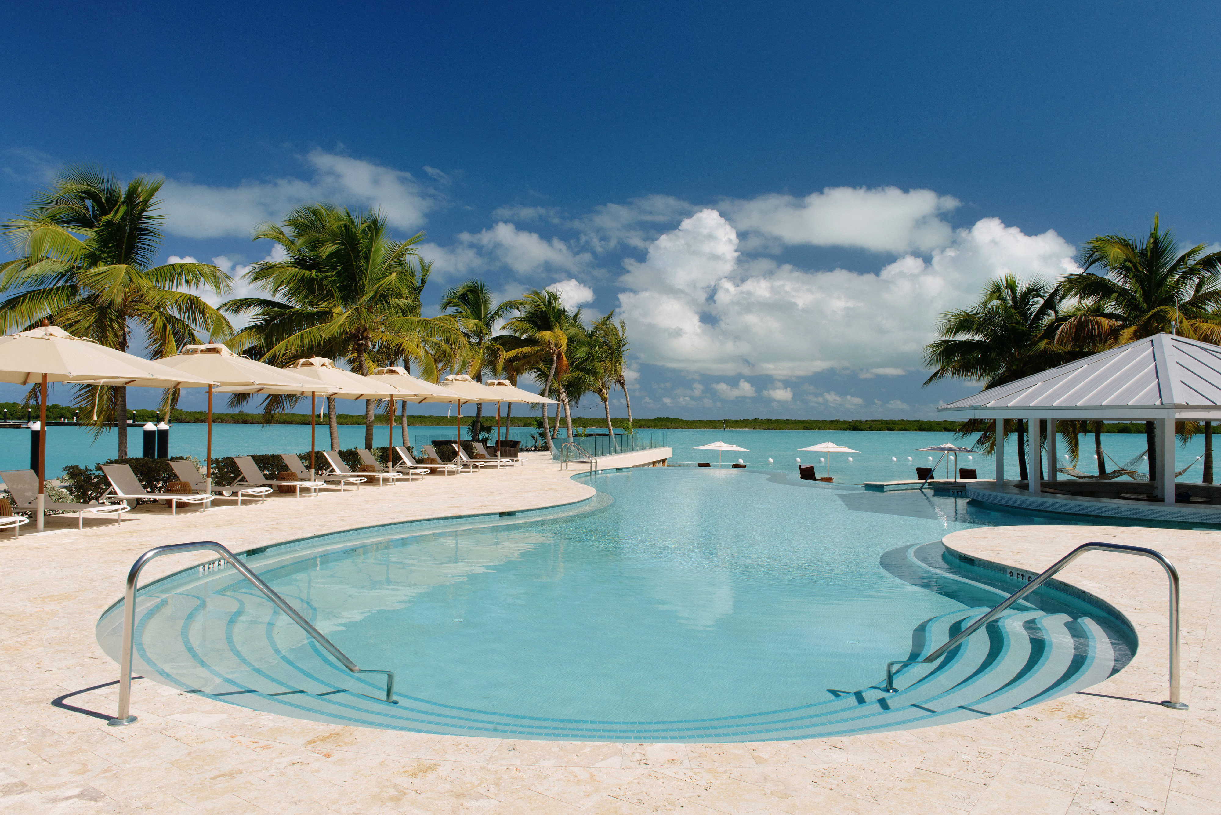 Beachfront Grounds Play Pool Resort sky swimming pool leisure Beach property caribbean Lagoon Ocean Sea shore Villa swimming sandy day