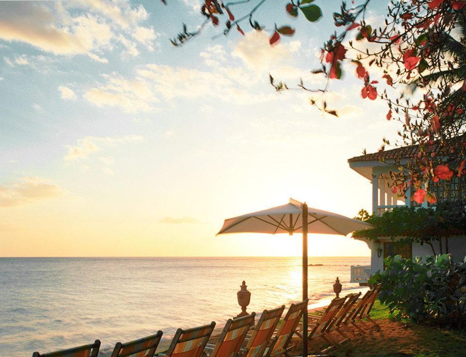 Beachfront Grounds Luxury Ocean Resort Scenic views Sunset sky water morning Beach Sea flower evening sunlight dusk line
