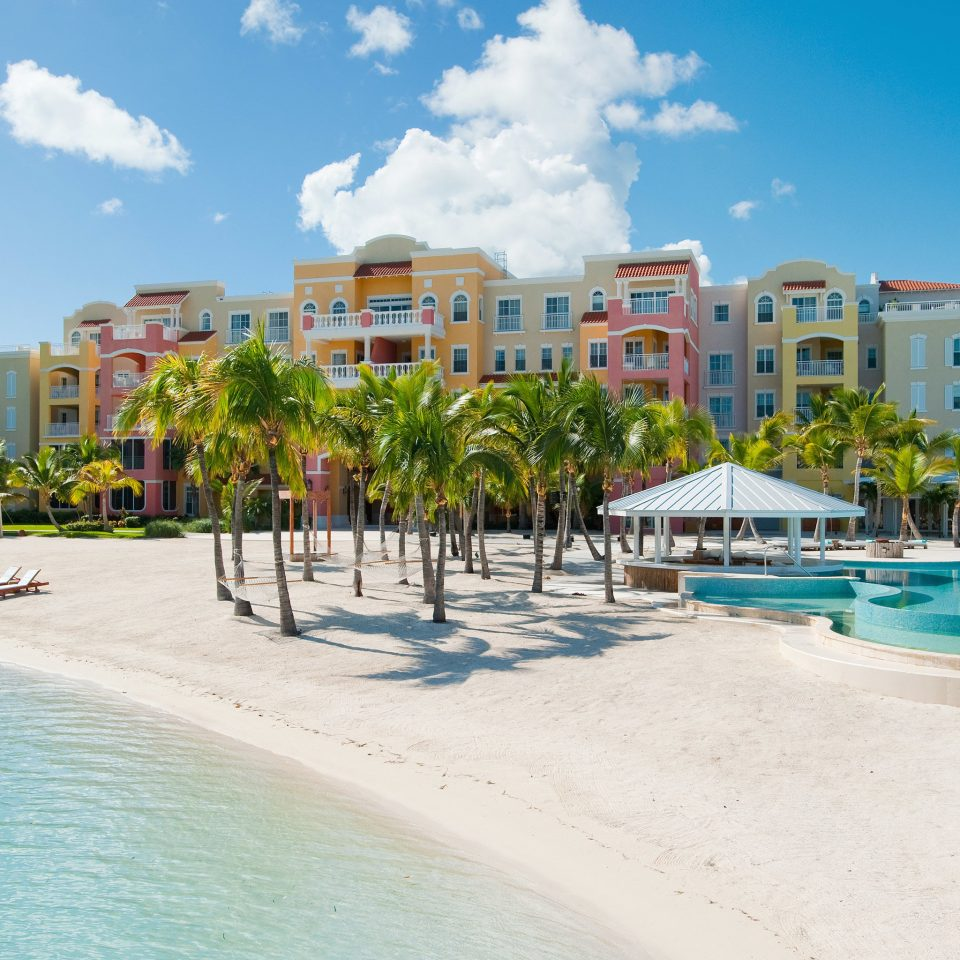 Beachfront Grounds Play Pool Resort sky water Beach leisure swimming pool Nature Sea condominium caribbean marina Water park walkway dock swimming sand shore sandy