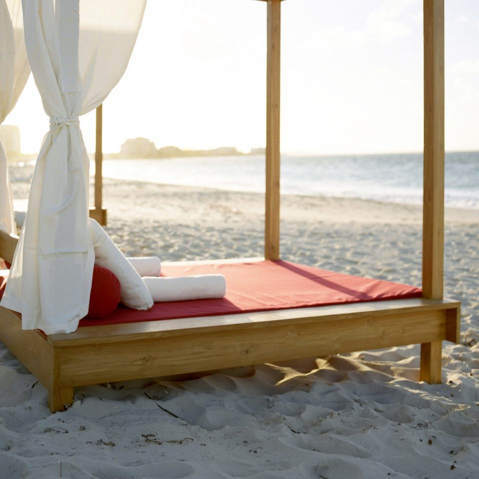 Beach Beachfront Grounds Romance Scenic views Wellness sky product wooden studio couch day sandy