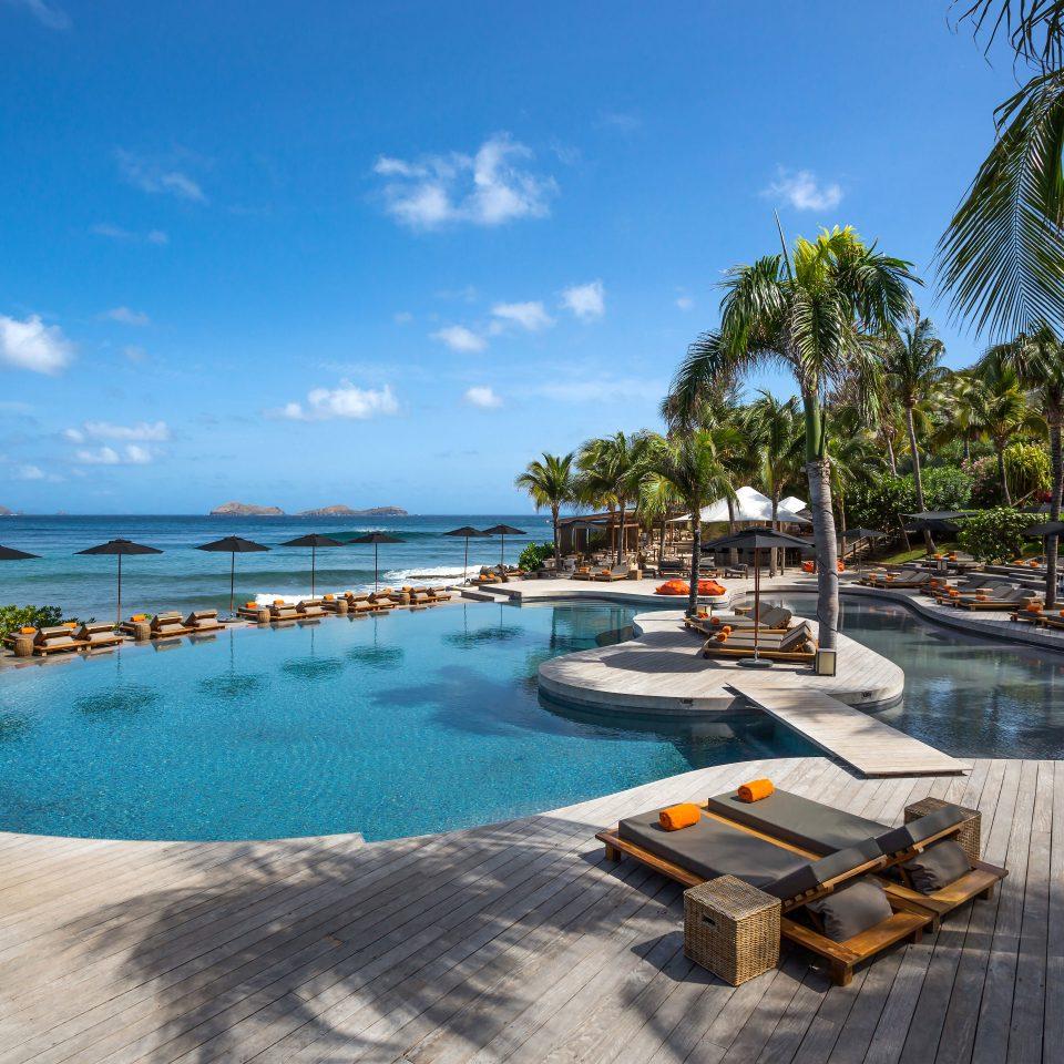 Beachfront Hip Lounge Luxury Modern Scenic views sky water swimming pool leisure property Resort caribbean Sea Beach resort town Lagoon Villa day