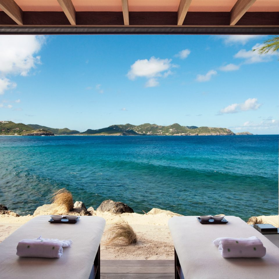Beachfront Hip Lounge Luxury Modern Scenic views water property leisure swimming pool Ocean Sea Villa caribbean Beach Resort home shore