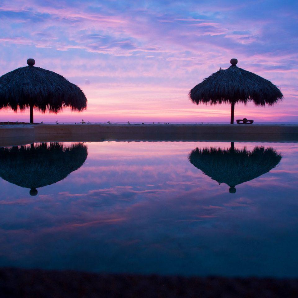 Beach Beachfront Honeymoon Pool Romance Romantic Sunset sky water horizon sunrise Sea Ocean dawn dusk morning clouds evening cloud atmosphere of earth cloudy dark distance