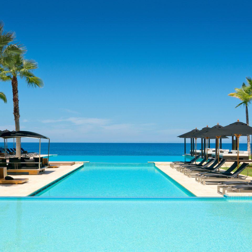 Beachfront Hotels Luxury Pool water sky Beach swimming swimming pool chair leisure blue property Resort caribbean condominium resort town marina Sea Villa Lagoon palm dock lined shore Island