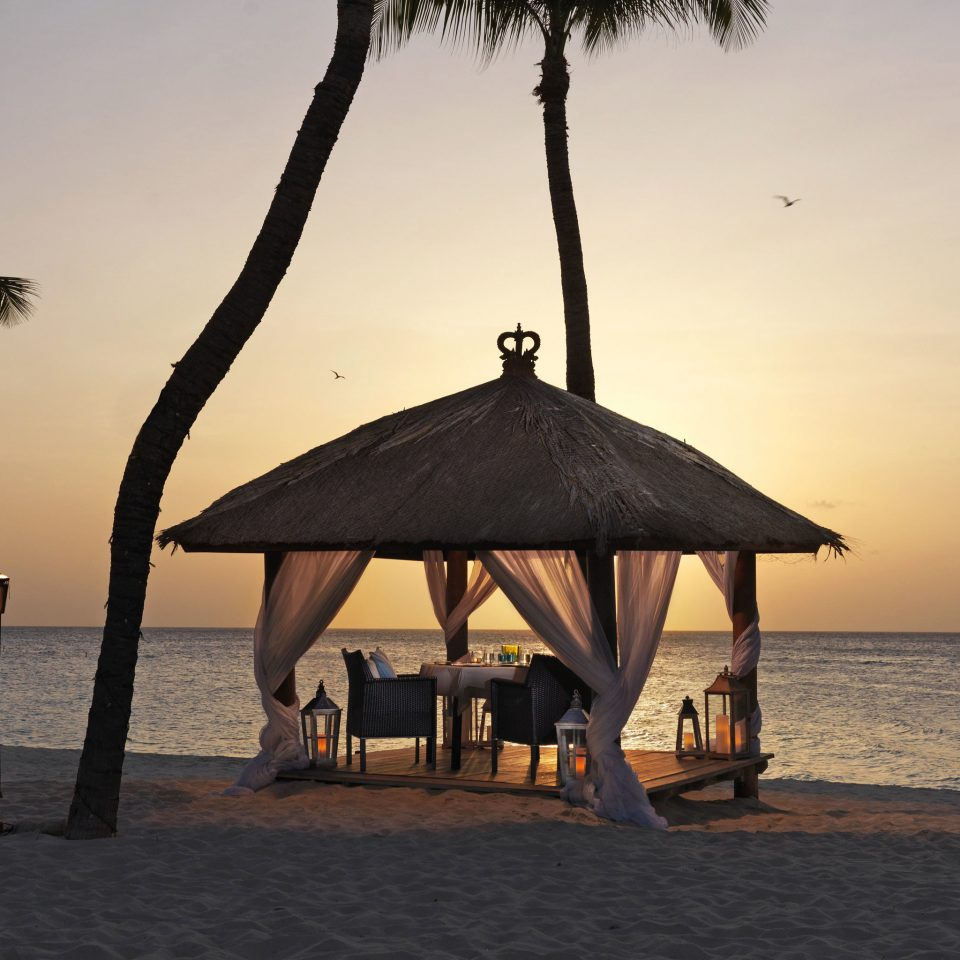 Beach Beachfront Hotels Lounge Luxury Ocean sky water chair Sea shore Sunset morning evening tree Nature palm dusk sand travel sailing vessel shade sandy day