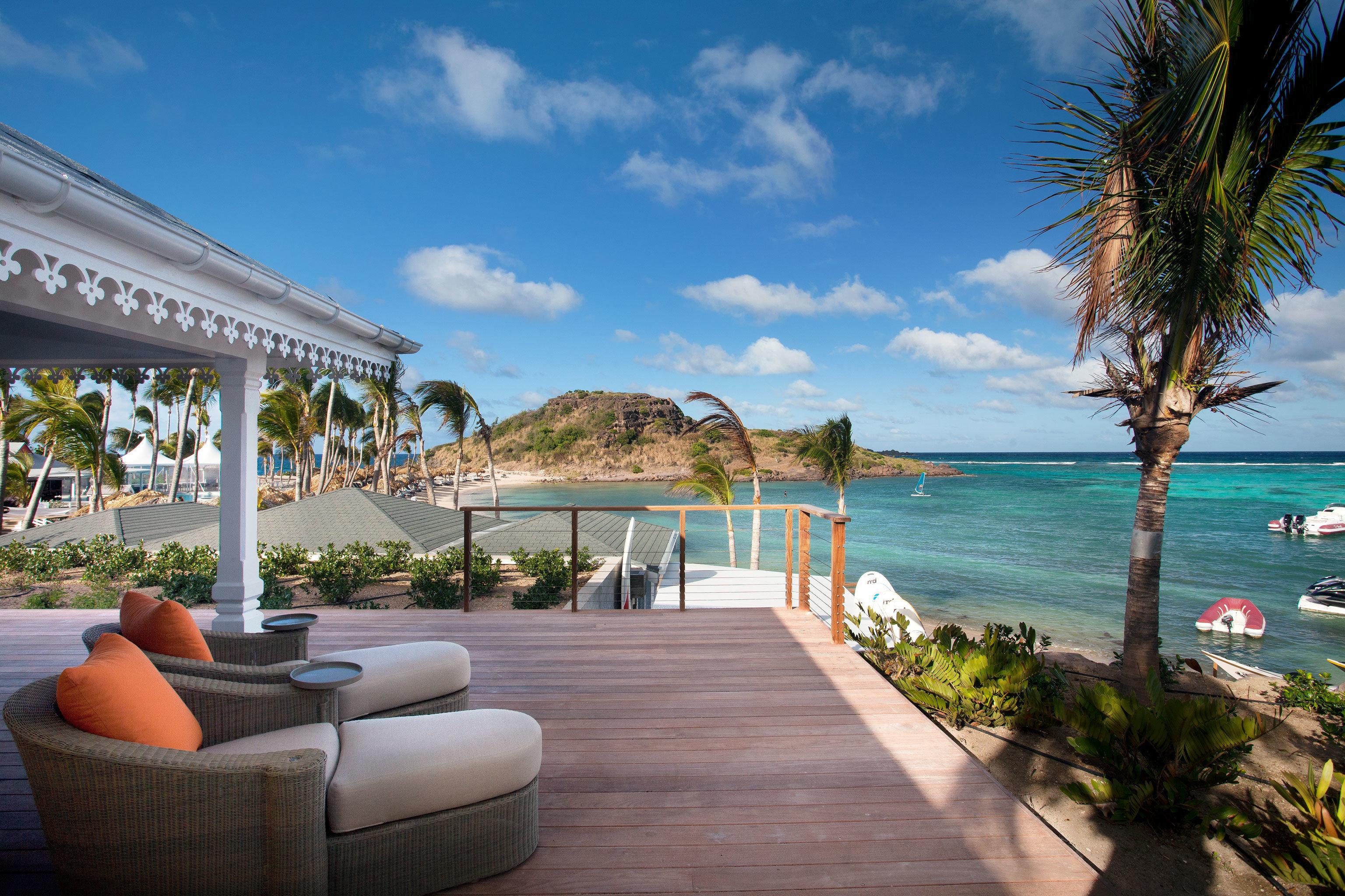 Beach Beachfront Hotels Lounge Ocean Trip Ideas sky water leisure property Resort swimming pool caribbean Villa Sea palm walkway condominium overlooking shore