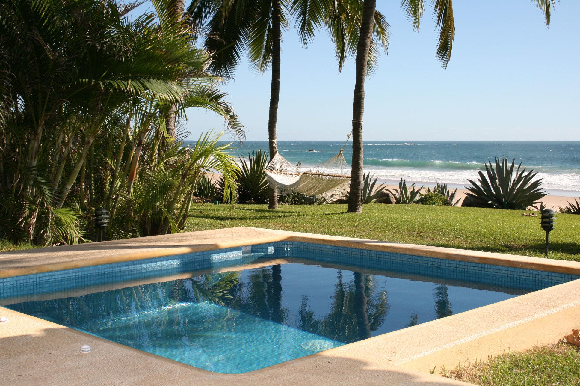 Beachfront Hotels Luxury Pool Romance Scenic views water tree sky palm swimming pool property Beach leisure swimming Resort Villa Ocean backyard home shore pond lined overlooking shade