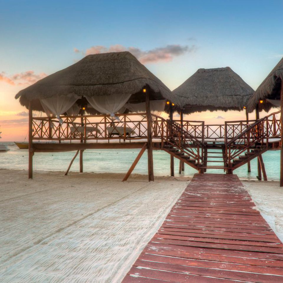 Beachfront Hotels Overwater Bungalow Romance Romantic Waterfront ground sky water Beach pier walkway Resort boardwalk Sea empty lined sandy