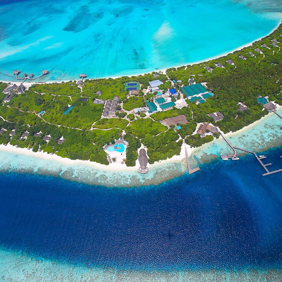 Beach Beachfront Island Romance Romantic Scenic views water swimming pool blue ecosystem Ocean Sea atmosphere of earth aerial photography atoll wave caribbean artificial island reef Lagoon swimming terrain