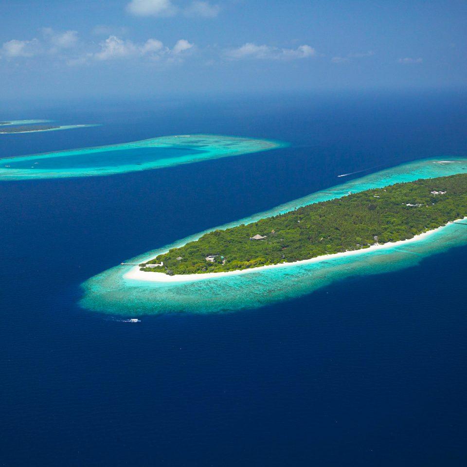 Beach Beachfront Luxury Ocean water sky reef Nature marine biology Sea archipelago blue atoll biology Island islet