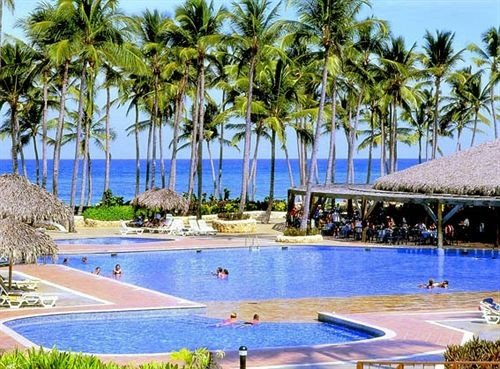 Beachfront Lounge Pool Tropical tree sky swimming pool property Resort leisure caribbean Beach palm condominium Villa resort town marina Lagoon Water park