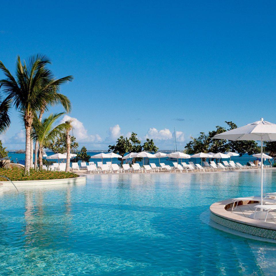 Beachfront Lounge Luxury Modern Pool Tropical sky water swimming pool Resort leisure caribbean Sea Lagoon Ocean resort town Beach blue swimming palm