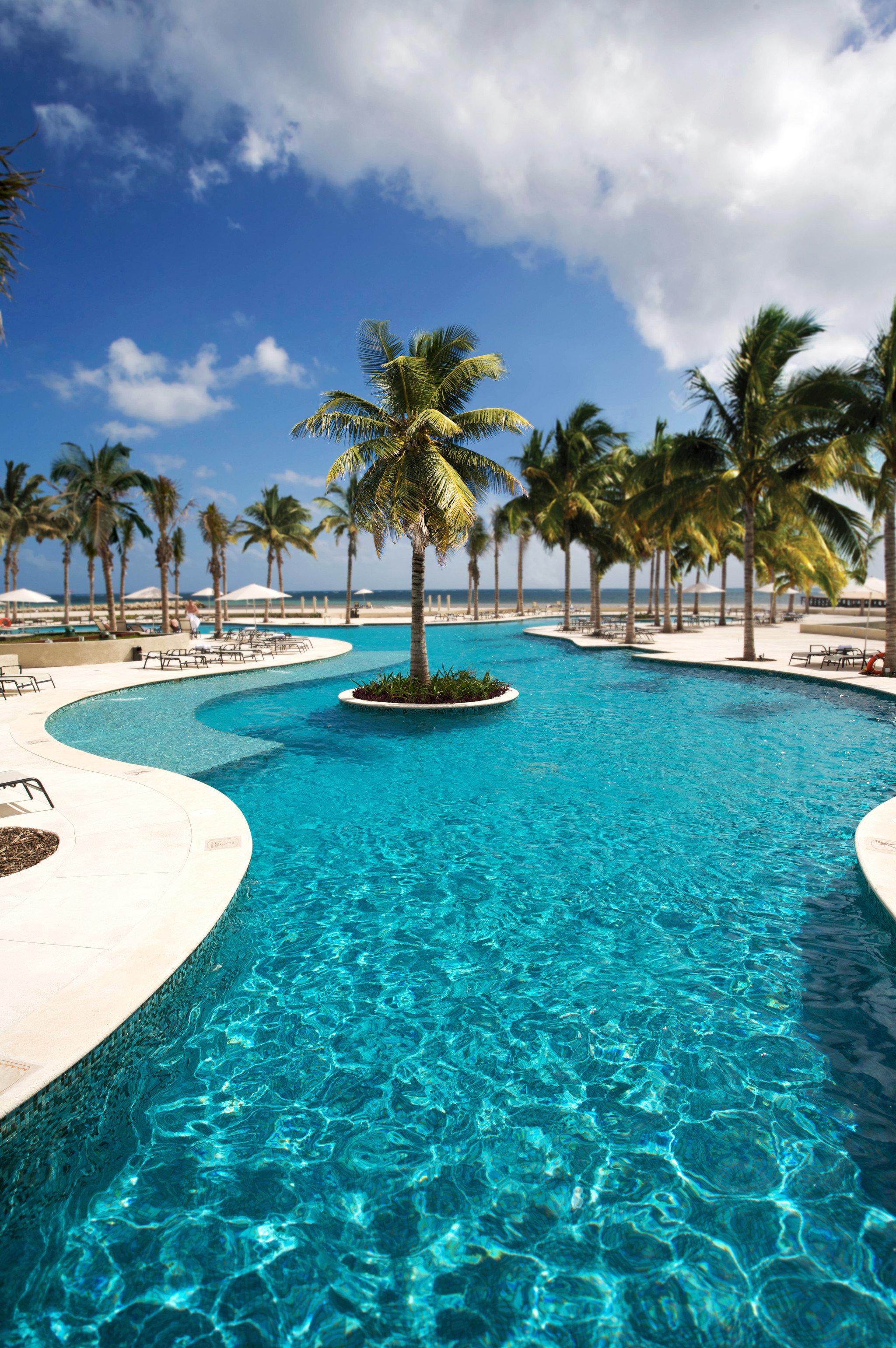 Beachfront Lounge Luxury Modern Pool sky water umbrella swimming pool Resort leisure caribbean Sea Lagoon swimming Ocean resort town reef Beach lawn blue tropics arecales sunny day shore