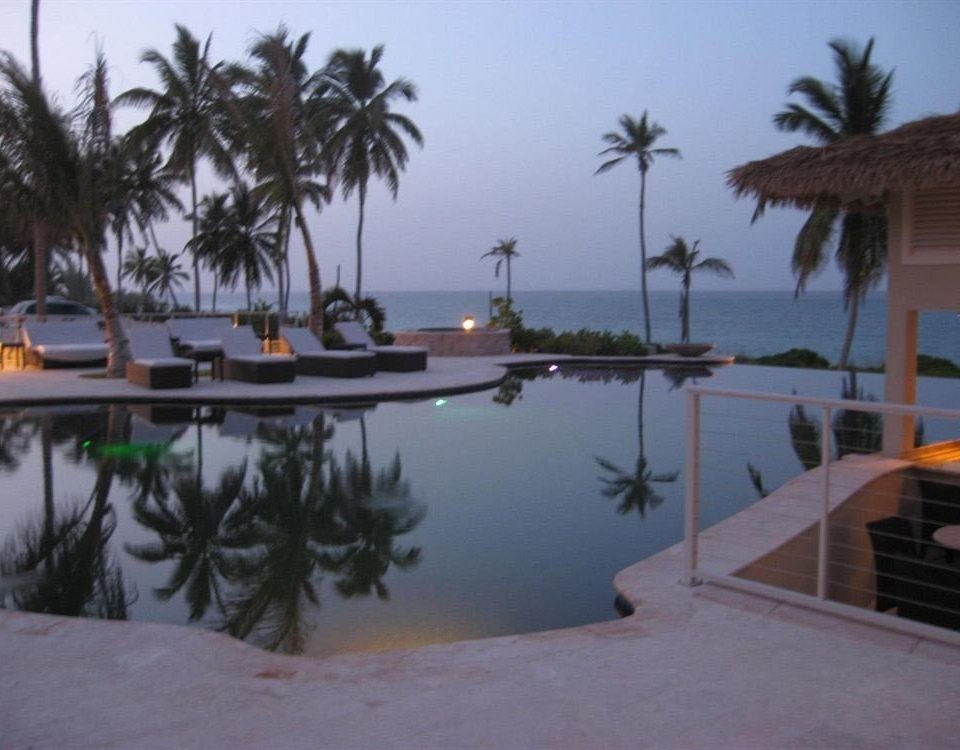 Beach Beachfront Lounge Luxury Ocean tree sky palm property Resort marina dock Villa Lagoon plant shore