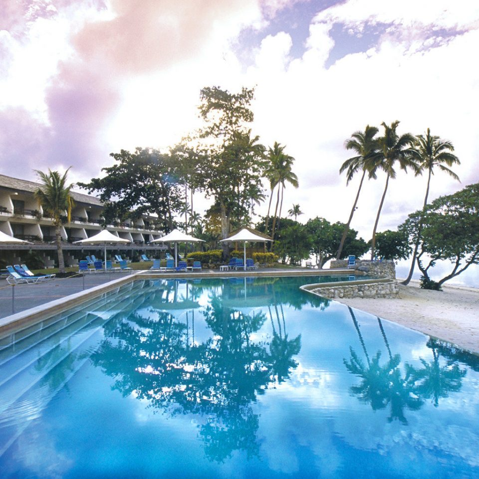 Beach Beachfront Luxury Ocean Pool sky tree swimming pool leisure Resort resort town Lagoon caribbean Sea empty palm day