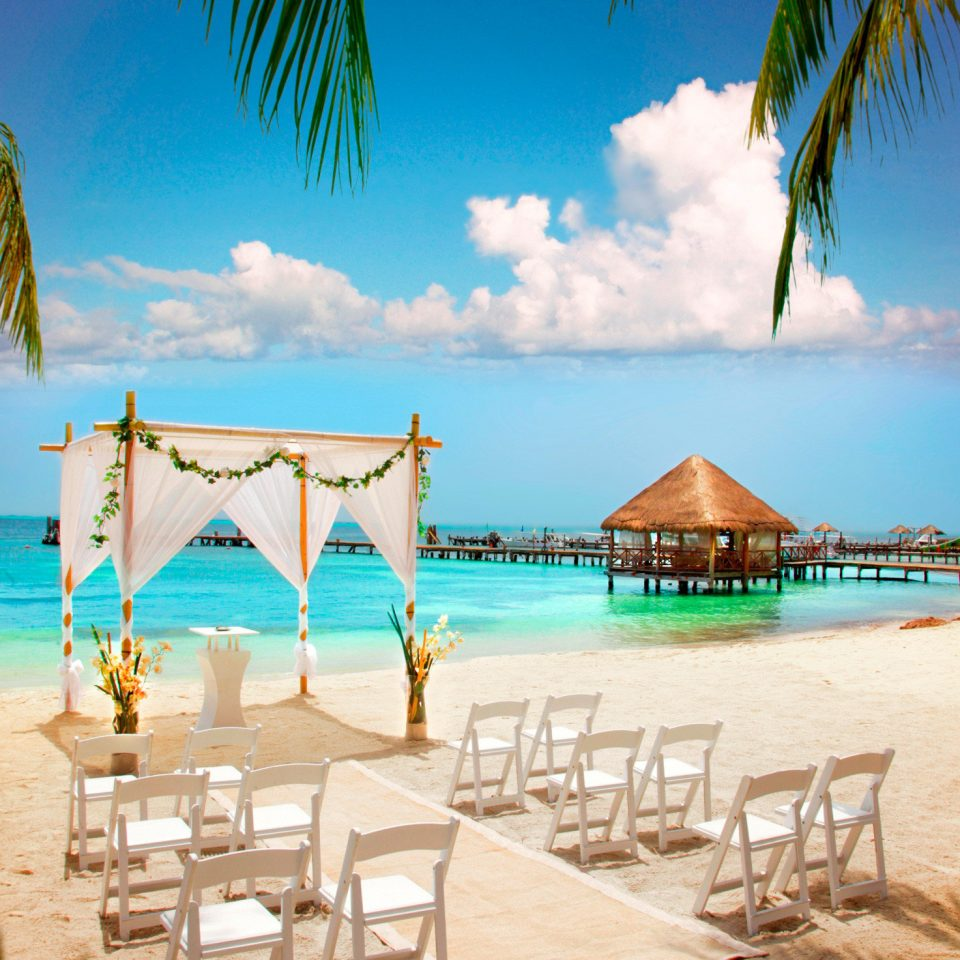 Beach Beachfront Luxury Ocean Play Romantic sky water chair umbrella leisure palm caribbean arecales Resort Sea tropics Lagoon lined plant sandy day swimming