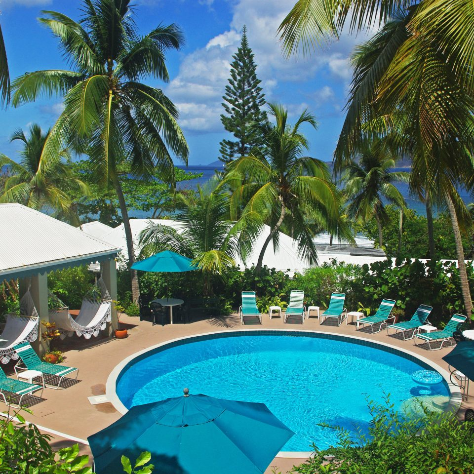 Beachfront Luxury Play Pool Resort Scenic views tree palm umbrella Beach swimming pool property leisure caribbean arecales plant resort town tropics Lagoon Villa lined swimming shade colorful sunny sandy