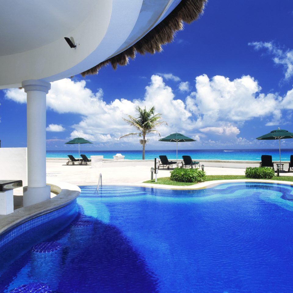 Beach Beachfront Pool Resort sky swimming pool property blue leisure caribbean Ocean Villa Lagoon Sea condominium