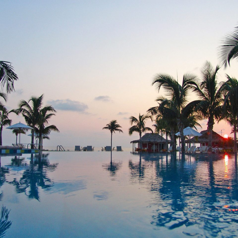 Beachfront Play Pool Resort Scenic views Sunset tree sky water palm Sea arecales Ocean tropics palm family evening Lagoon Beach dusk plant shore lined day