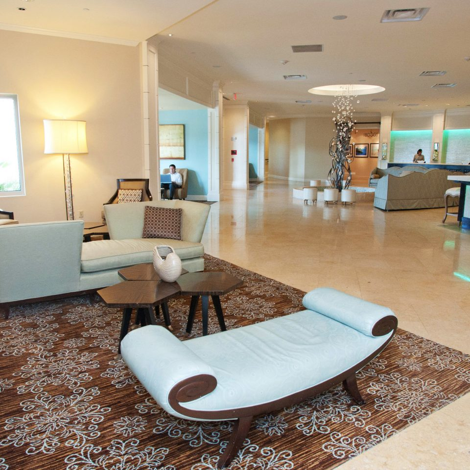 Beach Beachfront Lobby Resort property condominium living room waiting room home Suite