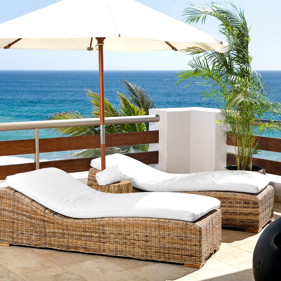 Beach Beachfront Lounge Luxury Patio sky water property swimming pool Ocean overlooking Villa home cottage living room condominium Resort Suite shore
