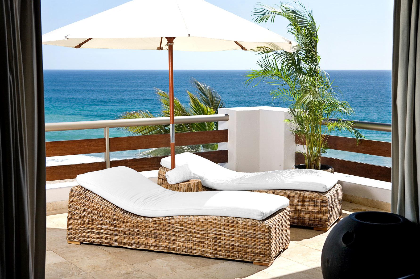Beach Beachfront Lounge Luxury Patio sky water property swimming pool Ocean overlooking Villa home cottage living room condominium Resort Suite shore