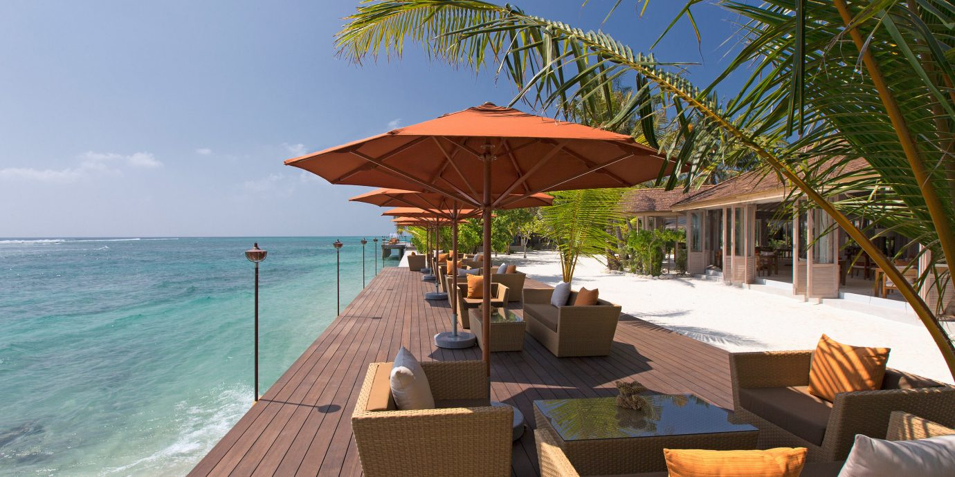 Beach Beachfront Lounge Luxury umbrella tree sky chair leisure property Resort caribbean swimming pool Sea Villa shore set overlooking