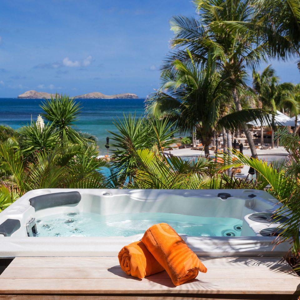 Beach Beachfront Lounge Luxury Ocean tree swimming pool leisure Resort caribbean palm Villa backyard